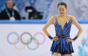 Photo - Mao Asada of Japan reacts after completing her routine in the women's free skate figure skating finals at the Iceberg Skating Palace during the 2014 Winter Olympics, Thursday, Feb. 20, 2014, in Sochi, Russia. (AP Photo/Ivan Sekretarev)
