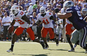 Photo - OSU's Johnny Thomas, left, returns an interception for a touchdown against Kansas State. PHOTO BY CHRIS LANDSBERGER, THE OKLAHOMAN