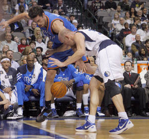 Photo - Oklahoma City's Nick Collison (4) and Dallas' Brian Cardinal (35) fight for a loose ball  during the pre season NBA game between the Dallas Mavericks and the Oklahoma City Thunder at the American Airlines Center in Dallas, Sunday, Dec. 18, 2011. Photo by Sarah Phipps, The Oklahoman