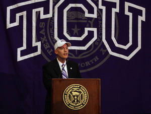Photo - Texas Christian Chancellor Victor J. Boschini Jr., speaks at a press conference  in Fort Worth, Texas, announcing TCU's acceptance of an invitation to join the Big 12 Conference Monday, Oct. 10, 2011. (AP Photo/Fort Worth Star-Telegram/Ian McVea)  ORG XMIT: TXFOR102