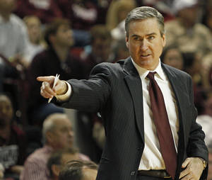 photo -   Mississippi State head coach Rick Stansbury directs his team during an NCAA college basketball game in Starkville, Miss., Saturday, Feb. 11, 2012. Georgia won in overtime 70-68. (AP Photo/Kerry Smith)  