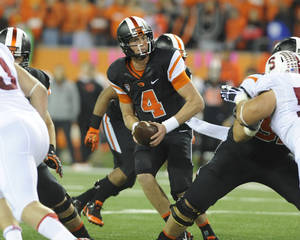 Photo - Oregon State's quarterback Sean Mannion (4) looks to pass against Stanford during the first half of an NCAA college football game in Corvallis, Ore., Saturday Oct. 26, 2013. Stanford beat Oregon State 20-12. (AP Photo/Greg Wahl-Stephens)