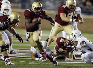 Photo - Boston College running back Andre Williams (44) evades Wake Forest safety A.J. Marshall (17) in the second quarter of an NCAA college football game in Boston, Friday, Sept. 6, 2013. (AP Photo/Michael Dwyer)