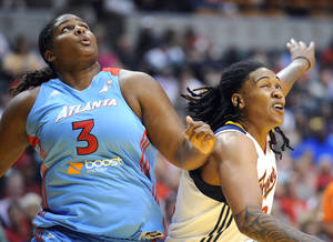 Photo - Indiana Fever's Erlana Larkins, right, battles Atlanta Dream's Courtney Paris for rebounding position during their WNBA basketball game, Saturday, May 19, 2012, in Indianapolis. (AP Photo/The Indianapolis Star, Rob Goebel) ORG XMIT: ININS301