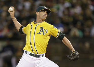 Photo - File-This Aug. 31, 2013 file photo shows Oakland Athletics closing pitcher Grant Balfour throwing against the Tampa Bay Rays in the ninth inning of their baseball game in Oakland, Calif. A person familiar with the contract says the Baltimore Orioles and free agent Balfour have agreed to a $15 million, two-year deal. (AP Photo/Eric Risberg, File)