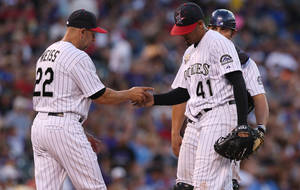 Photo - Colorado Rockies manager Walt Weiss, left, takes ball from starting pitcher Jair Jurrjens (41) as catcher Michael McKenry looks on in the fifth inning of a baseball game against the Los Angeles Dodgers in Denver, Friday, July 4, 2014. (AP Photo/David Zalubowski)