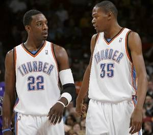 Photo - Oklahoma City's  Kevin  Durant and Jeff Green talk during their game against Sacramento at the Ford Center in Oklahoma City on Sunday, Feb. 8, 2009. By John Clanton.