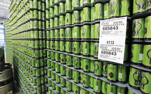 Photo -  Empty beer cans stacked and ready for processing at the new location for COOP Ale Works, in Oklahoma City.  <strong>PAUL B. SOUTHERLAND -  PAUL B. SOUTHERLAND </strong>
