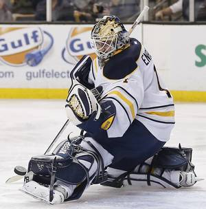 Photo - Buffalo Sabres goalie Jhonas Enroth makes a save against the Boston Bruins during the second period of Boston's 4-1 win in an NHL hockey game in Boston, Saturday, Dec. 21, 2013. (AP Photo/Winslow Townson)