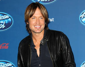 """Photo - FILE - This Jan. 9, 2013 file photo shows Keith Urban at the """"American Idol"""" premiere event at Royce Hall on the campus of UCLA in Los Angeles. Urban is a judge on the singing competition series airing Wednesdays and Thursdays on Fox. (Photo by Matt Sayles/Invision/AP, file)"""