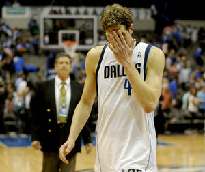 Photo - 3Dallas Mavericks forward Dirk Nowitzki (41) walks off the court after the Mavericks lost 122-120 to the Golden State Warriors in overtime, during a NBA basketball game, Tuesday, April 1, 2014, in Dallas. Golden State won 122-120 in overtime. (AP Photo/Matt Strasen)