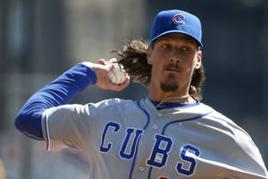 Photo - Chicago Cubs starting pitcher Jeff Samardzija throws in the second inning against the Pittsburgh Pirates during their opening day baseball game on Monday, March 31, 2014, in Pittsburgh. (AP Photo/Gene Puskar)