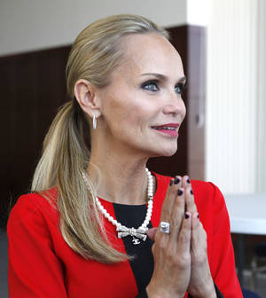 Photo - Actress Kristin Chenoweth speaks with Oklahoman writer Silas Allen before receiving an honorary PhD. from Oklahoma City University in Oklahoma City, OK, Saturday, May 11, 2013,  By Paul Hellstern, The Oklahoman