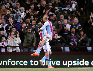 Photo - Aston Villa's  Fabian Delph, right, celebrates after scoring against Chelsea during the English Premier League soccer match between Aston Villa and Chelsea at Villa Park, Birmingham, England, Saturday, March 15, 2014.  (AP Photo/Rui Vieira)
