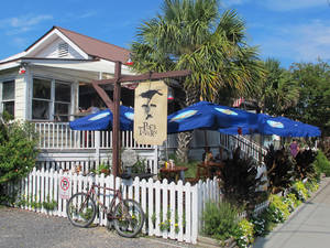 Photo - Poe's Tavern, a restaurant on Sullivans Island, S.C., is seen in this Sept. 12, 2013 photo. The restaurant is one of about a dozen on Sullivans Island just outside Charleston, S.C. (AP Photo/Bruce Smith)