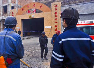 Photo - In this Friday, Dec. 13, 2013 photo released by China's Xinhua News Agency, miners wait at the entrance to the Baiyanggou coal mine after a gas explosion occurred, in Xinjiang region's Changji prefecture, western China. An official at the Xinjiang region's work safety bureau said Saturday, Dec. 14, 2013 that 21 miners were confirmed dead and another one who had been trapped was injured. (AP Photo/Xinhua, Zhao Ge)  NO SALES