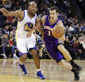 Photo -   Phoenix Suns' Goran Dragic, right, drives the ball past Golden State Warriors' Jarrett Jack during the first half of an NBA preseason basketball game, Tuesday, Oct. 23, 2012, in Oakland, Calif. (AP Photo/Ben Margot)
