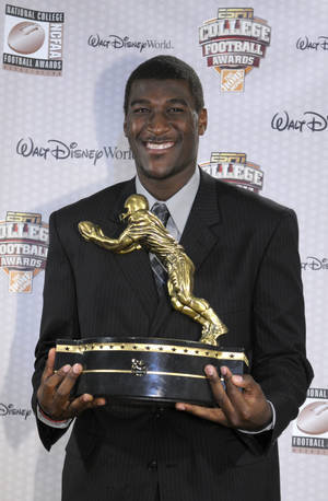 photo - Oklahoma State wide receiver Justin Blackmon holds the Biletnikoff Award trophy at the  ESPNU College Football Awards show in Lake Buena Vista, Fla., on Thursday. AP Photo
