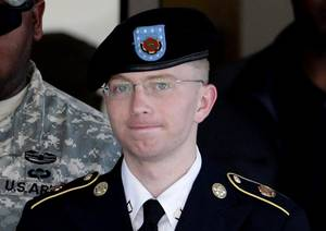 Photo -   FILE - In this June 25, 2012 file photo, Army Pfc. Bradley Manning, right, is escorted out of a courthouse in Fort Meade, Md. Manning is charged with aiding the enemy by causing hundreds of thousands of classified documents to be published on the secret-sharing website WikiLeaks. (AP Photo/Patrick Semansky, File)