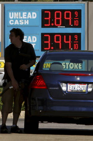 photo - In this file photo, a man fills his gas tank at a gas station in Lyndhurst, Ohio. AP Photo &lt;strong&gt;Tony Dejak - AP&lt;/strong&gt;