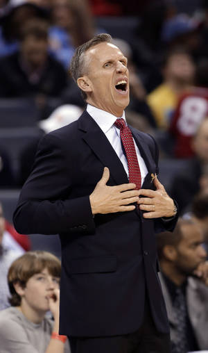 Photo - Charlotte Bobcats coach Mike Dunlap reacts to a call that went the Denver Nuggets' way during the second half of an NBA basketball game in Charlotte, N.C., Saturday, Feb. 23, 2013. The Nuggets won 113-99. (AP Photo/Bob Leverone)