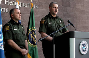 Photo -   Cmdr. Jeffrey Self, of U.S. Customs and Border Protection, flanked to his left by Acting Chief Patrol Agent Manuel Padilla, releases a statement on Friday, Oct. 5, 2012, at the Tucson Sector Headquarters in Tucson, Ariz. A preliminary investigation has found friendly fire likely was to blame in a shooting that killed U.S. Border Patrol Agent Nicholas J. Ivie and wounded another along the Arizona-Mexico border, the FBI said Friday, shaking up the probe into an incident that re-ignited the political debate over security on the border. (AP Photo/Arizona Daily Star, Mike Christy) ALL LOCAL TV OUT; PAC-12 OUT; MANDATORY CREDIT