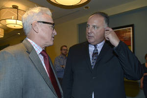 Photo - Tampa Bay Rays manager Joe Maddon , left, chats with Los Angeles Angels manager Mike Scioscia at baseball's winter meetings in Lake Buena Vista, Fla., Wednesday, Dec. 11, 2013.(AP Photo/Phelan M. Ebenhack)