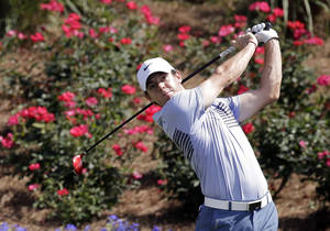 Photo - Rory McIlroy, of Northern Ireland, hits a shot from the 18th tee during a practice round for The Players championship golf tournament at TPC Sawgrass in Ponte Vedra Beach, Fla., Wednesday, May 7, 2014. (AP Photo/John Raoux)
