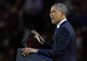 photo -   President Barack Obama addresses the crowd at his election night party Wednesday, Nov. 7, 2012, in Chicago. President Obama defeated Republican challenger former Massachusetts Gov. Mitt Romney. (AP Photo/M. Spencer Green)  