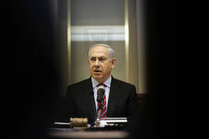 photo - Israeli Prime Minister Benjamin Netanyahu heads the weekly Cabinet meeting at his Jerusalem office, Sunday, Jan. 27, 2013. (AP Photo/Ariel Schalit)