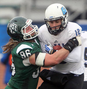 Photo - Northwest Missouri State defensive end Matt Longacre sacks Grand Valley State quarterback Heath Parling Saturday, Dec. 14, 2012. Longacre had three sacks in the Bearcat's victory at Bearcat Stadium in Maryville, Mo. (AP Photo/St. Joseph News-Press, Jessica A. Stewart)