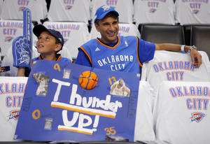 Photo - Bassam Hadi and his son Raye Hadi,11, of Oklahoma City, wait for the start of Game 6 of the Western Conference Finals between the Oklahoma City Thunder and the San Antonio Spurs in the NBA playoffs at the Chesapeake Energy Arena in Oklahoma City, Wednesday, June 6, 2012. Photo by Bryan Terry, The Oklahoman