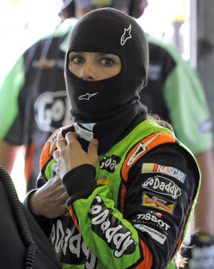 Photo - Danica Patrick prepares before practice for Sunday's NASCAR Sprint Cup series auto race at Charlotte Motor Speedway in Concord, N.C., Thursday, May 22, 2014. (AP Photo/Mike McCarn)