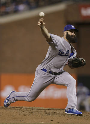 Photo - Los Angeles Dodgers pitcher Brian Wilson throws against the San Francisco Giants during the eighth inning of a baseball game in San Francisco, Tuesday, Sept. 24, 2013. (AP Photo/Jeff Chiu)