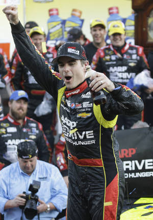 Photo - Jeff Gordon celebrates winning the NASCAR Sprint Cup  auto race at Martinsville Speedway in Martinsville, Va., Sunday, Oct. 27, 2013. (AP Photo/Steve Helber)