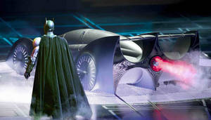 "Photo - Batman and the Batmobile in ""Batman Live."""