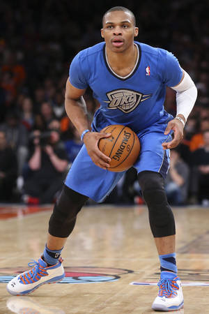 Photo - Oklahoma City Thunder guard Russell Westbrook looks to pass during the second half of Thunder's NBA basketball game against the New York Knicks at Madison Square Garden, Wednesday, Dec. 25, 2013, in New York. The Thunder won 123-94. (AP Photo/John Minchillo)