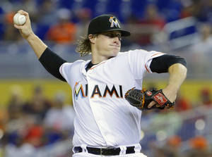 Photo - Miami Marlins' Tom Koehler delivers a pitch during the first inning of a baseball game against the Philadelphia Phillies, Wednesday, July 2, 2014 in Miami. (AP Photo/Wilfredo Lee)