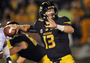 photo -   FILE - In this Sept. 15, 2012, file photo, Missouri quarterback Corbin Berkstresser throws during the third quarter of an NCAA college football game against Arizona State in Columbia, Mo. Berkstresser made his first career start Saturday, realizing a lifelong dream. With James Franklin nursing an inflamed shoulder on the sideline, Berkstresser led the Tigers to a 24-20 win over Arizona State. (AP Photo/L.G. Patterson, File)
