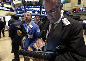 Photo - Trader Kenneth Polcari, right, works on the floor of the New York Stock Exchange Tuesday, Oct. 15, 2013.The stock market edged lower early Tuesday even though Republican and Democratic leaders in the Senate reported that a deal over the nation's borrowing limit appears to be getting closer. (AP Photo/Richard Drew)