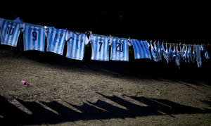 Photo - 10ThingstoSeeSports - Argentina's national soccer team T-shirts hang for sale outside the Argentine Soccer Association before the team heads the airport in Buenos Aires, Argentina, Monday, June 9, 2014. Argentina's team is leaving Monday to compete in the Brazil's 2014 soccer Word Cup. (AP Photo/Natacha Pisarenko, File)