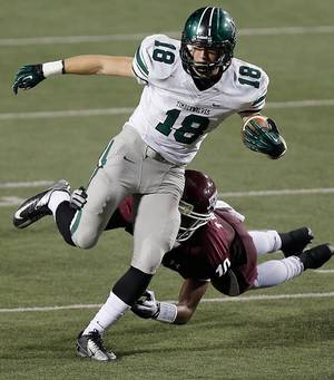 photo - Norman North's Tyler Sipe (18) makes a reception in front of Jenks' Steven Parker  (10) during the Class 6A Oklahoma state championship football game between Norman North High School and Jenks High School at Boone Pickens Stadium on Friday, Nov. 30, 2012, in Stillwater, Okla.   Photo by Chris Landsberger, The Oklahoman