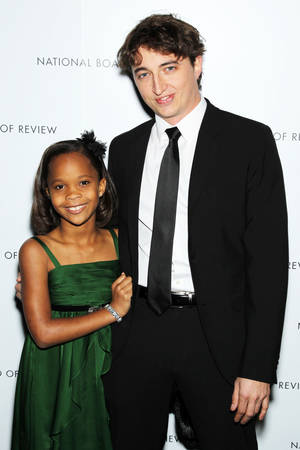 "Photo - This Jan. 8, 2013 photo released by Starpix shows actress Quvenzhane Wallis, left, and director Benh Zeitlin at the National Board of Review awards gala in New York. Wallis was nominated for an Academy Award on Thursday, Jan. 10, 2013, for best actress for the film, ""Beasts of the Southern Wild"".   Zeitlin was also nominated for best director. The 85th Academy Awards will air live on Sunday, Feb. 24, 2013 on ABC. (AP Photo/Starpix, Marion Curtis)"