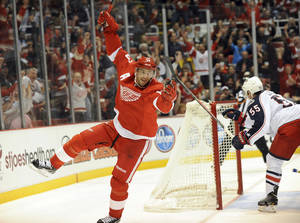 Photo - Detroit Red Wings center Pavel Datsyuk celebrates his second period goal against the Columbus Blue Jackets during an NHL hockey game at Joe Louis Arena in Detroit, Tuesday, Oct. 15, 2013.(AP Photo/Lon Horwedel)