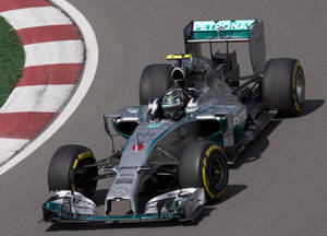 Photo - Mercedes driver Nico Rosberg from Germany during the first practice session Friday, June 6, 2014, at the Canadian Grand Prix in Montreal. (AP Photo/The Canadian Press, Jacques Boissinot)
