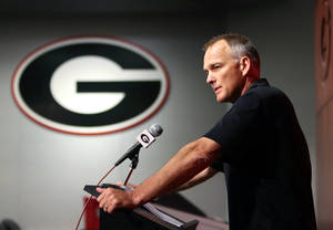 Photo - Georgia coach Mark Richt speaks to reporters during the team's NCAA college football weekly news conference at the University of Georgia, Tuesday, Aug. 27, 2013, in Athens, Ga. (AP Photo/Atlanta Journal-Constitution, Jason Getz)