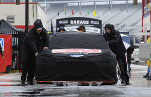 Photo - The crew for Greg Biffle roll their covered car during setups for the NASCAR Sprint Cup Series auto race at Texas Motor Speedway in Fort Worth, Texas, Sunday, April 6, 2014. (AP Photo/Ralph Lauer)