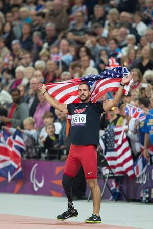 photo - U.S. Paralympic athlete Jeremy Campbell celebrates at the 2012 Paralympic Games in London after winning a gold medal in the men's F44 discus throw.