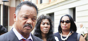 Photo - Reverend Jesse Jackson, left, Alice Williams, mother of Darrell Williams, and Tarina Williams, a cousin, speak with the media after the sentencing hearing for the former Oklahoma State basketball player was continued on Friday.  Photo by David McDaniel, The Oklahoman