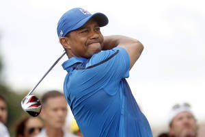 Photo - Tiger Woods hits from the second tee during the first round of the Cadillac Championship golf tournament Thursday, March 6, 2014, in Doral, Fla. (AP Photo/Marta Lavandier)